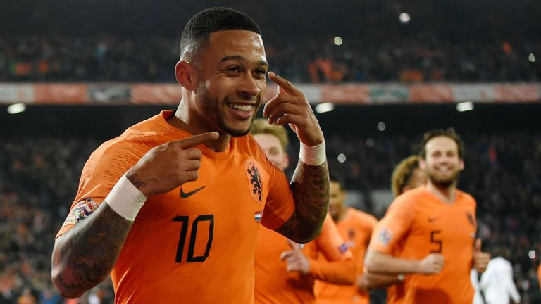 Memphis Depay celebrates his late goal against France