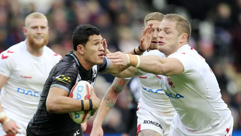 Burgess tackles Dallin Watene-Zelezniak during the 20-14 win for England
