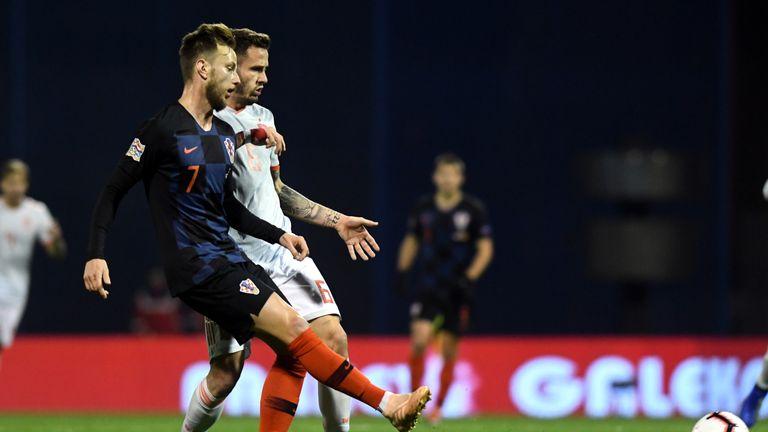 Croatia's midfielder Ivan Rakitic (L) vies with Spain's midfielder Saul Niguez