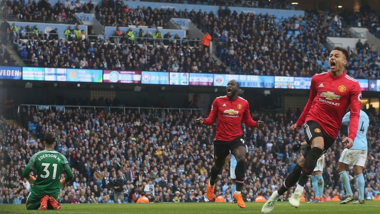 Jesse Lingard celebrates against Manchester City