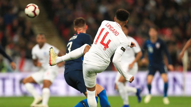 Jesse Lingard curls home England's opener