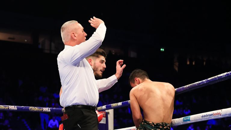 The referee waves off the fight