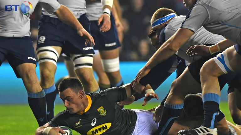 South Africa's centre Jesse Kriel dives over the line to score the opening try