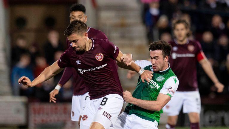 Hearts' Olly Lee holds off Hibernian's Stevie Mallan