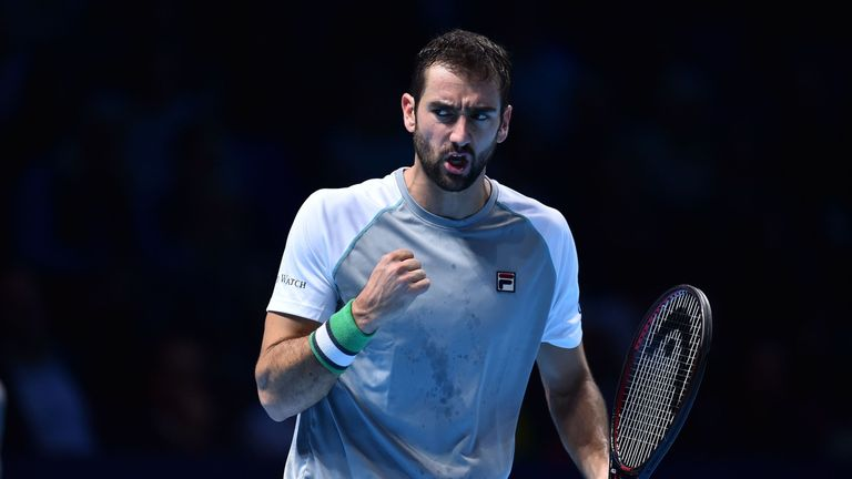 Marin Cilic reacts after a point against US player John Isner during their men's singles round-robin match on day four of the ATP World Tour Finals tennis tournament at the O2 Arena in London on November 14, 2018.