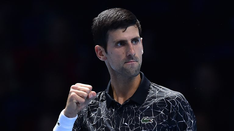 Novak Djokovic reacts after breaking the serve of US player John Isner to go 3-2 in the first set, during their men's singles round-robin match on day two of the ATP World Tour Finals tennis tournament at the O2 Arena in London on November 12, 2018