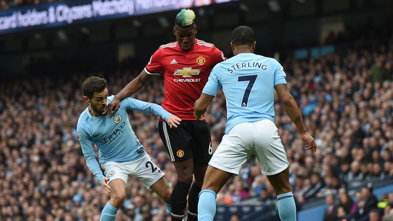 Paul Pogba and Raheem Sterling battle in last year's Manchester derby