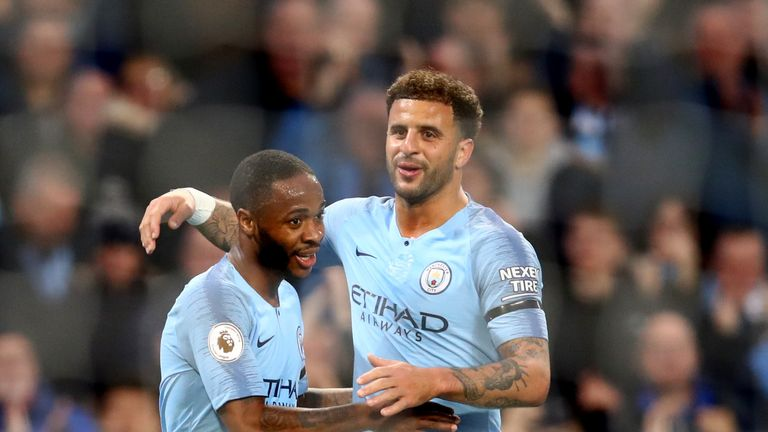 Raheem Sterling celebrates with Kyle Walker after putting City 5-1 up