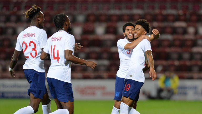 Reiss Nelson celebrates scoring against Scotland