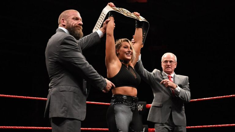 Rhea Ripley is presented with the NXT UK women's championship by Triple H and NXT UK general manager Johnny Saint