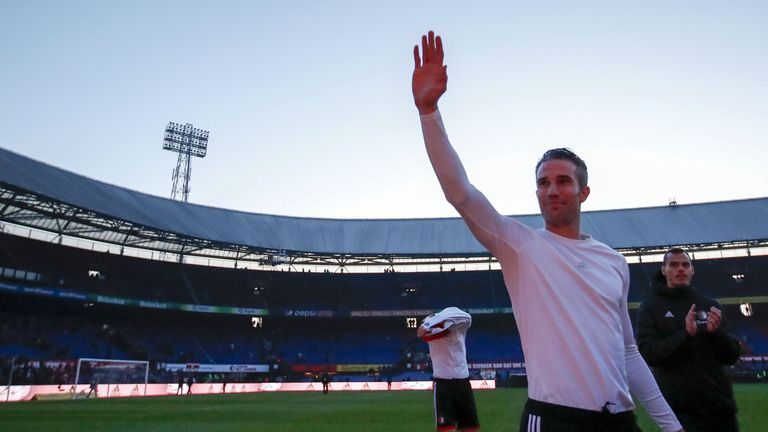 Robin van Persie waves to Feyenoord fans after their game against VVV was suspended due to floodlight failure