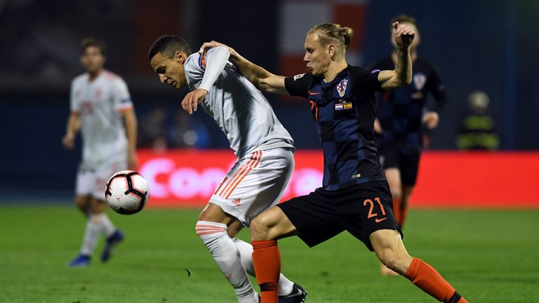 Spain's Rodrigo (L) vies for the ball with Croatia's Domagoj Vida