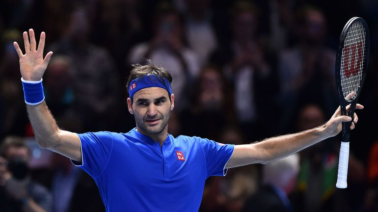 Roger Federer celebrates beating South Africa's Kevin Anderson in their men's singles round-robin match on day five of the ATP World Tour Finals tennis tournament at the O2 Arena in London on November 15, 2018.