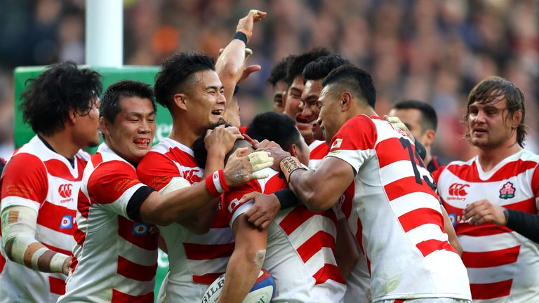 Ryoto Nakamura of Japan is congratulated by team-mates after scoring during the Quilter International match between England and Japan at Twickenham Stadium on November 17, 2018 in London, United Kingdom.
