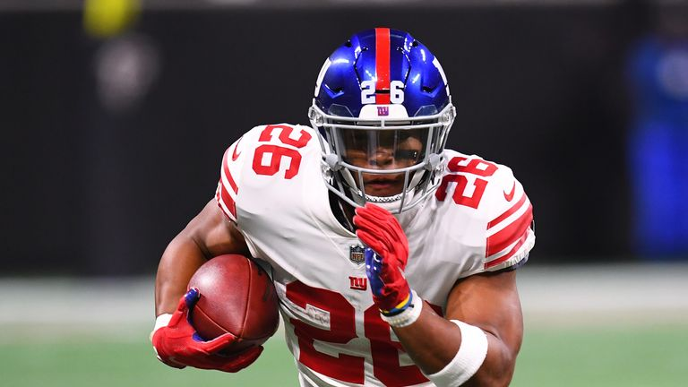 ATLANTA, GA - OCTOBER 22: Saquon Barkley #26 of the New York Giants runs the ball during the second quarter against the New York Giants at Mercedes-Benz Stadium on October 22, 2018 in Atlanta, Georgia. (Photo by Scott Cunningham/Getty Images)