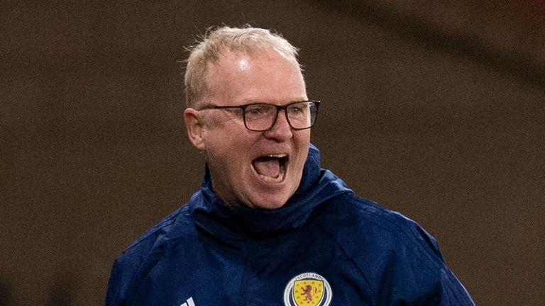 Scotland manager Alex McLeish celebrates James Forrest's second goal