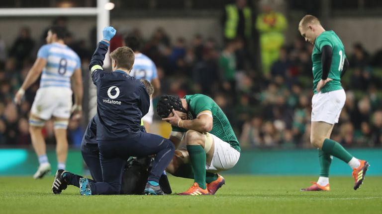 Sean O'Brien reacts after fracturing his forearm against Argentina