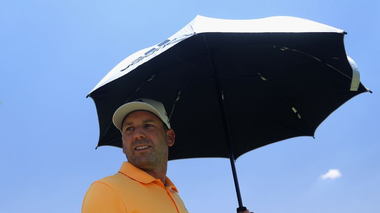 Sergio Garcia shades himself from the sun during the third round