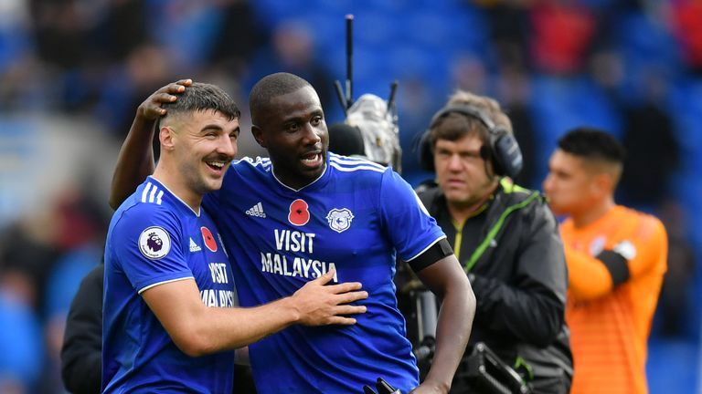 Goalscorers Callum Paterson and Sol Bamba celebrate Cardiff's win over Brighton