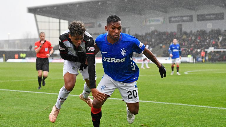St Mirren's Ethan Erhahon challenges Rangers' Alfredo Morelos in a wet and windy Paisley encounter