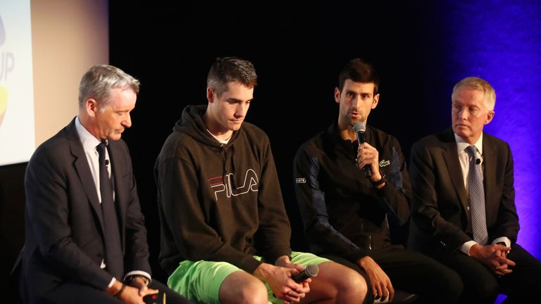 Djokovic sits alongside ATP executive chairman and president Chris Kemode (left), John Isner and far right Craig Tiley CEO of Tennis Australia