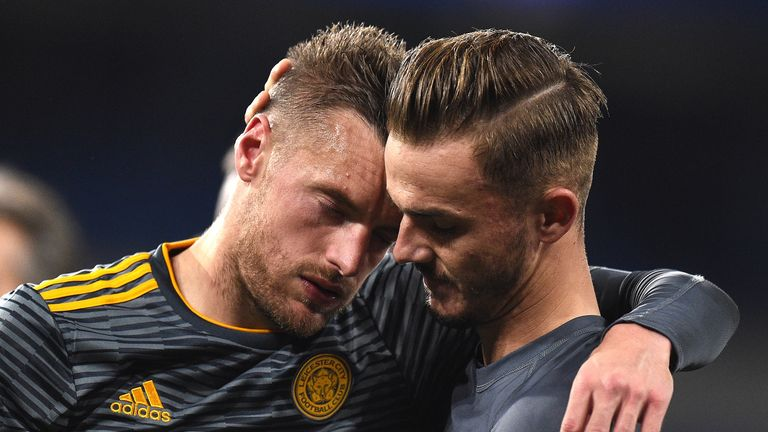 Jamie Vardy and James Morrison embrace after Leicester's win at Cardiff