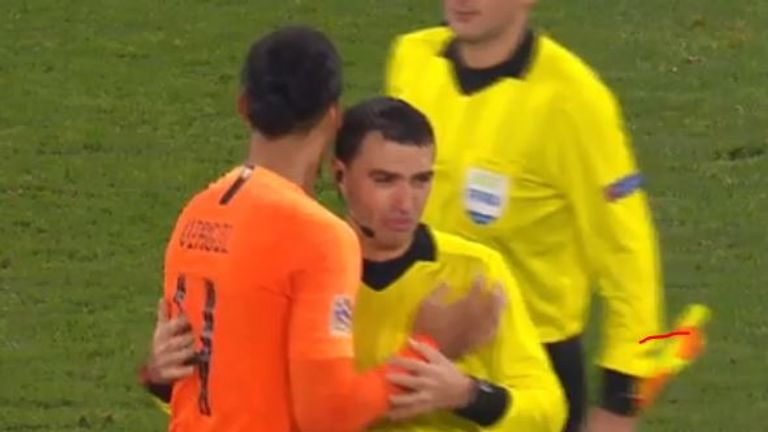 Virgil van Dijk comforts referee after Holland match