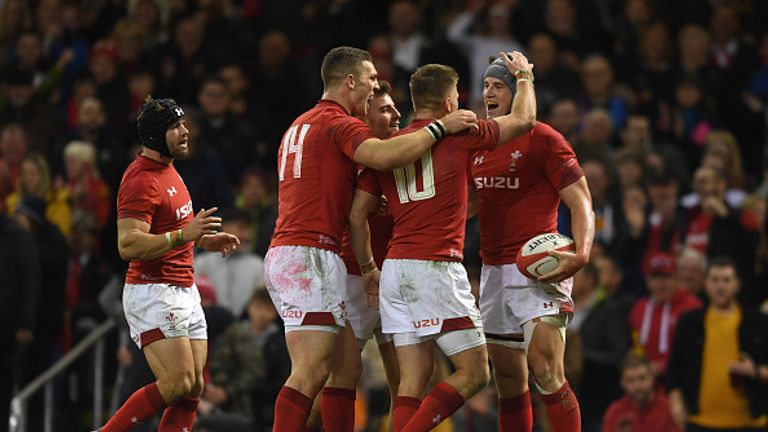 Jonathan Davies celebrates scoring in Wales' victory over Scotland