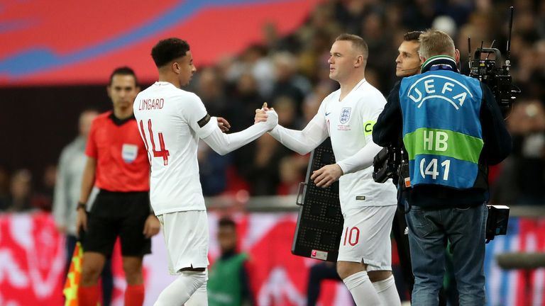 Wayne Rooney comes on for his 120th cap