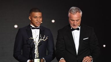 Kylian Mbappe receives his award at the Ballon d'Or ceremony in Paris