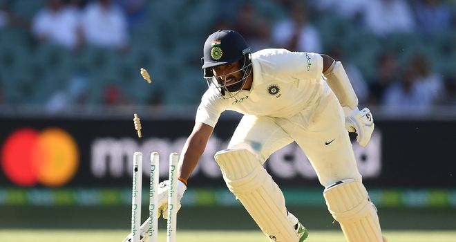 Pujara was dismissed on the second last ball of the day by a diving Pat Cummins