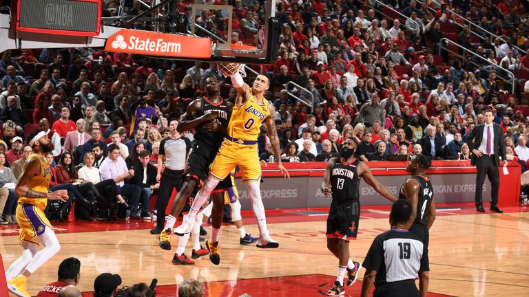 Kyle Kuzma throws down a powerful dunk on Clint Capela