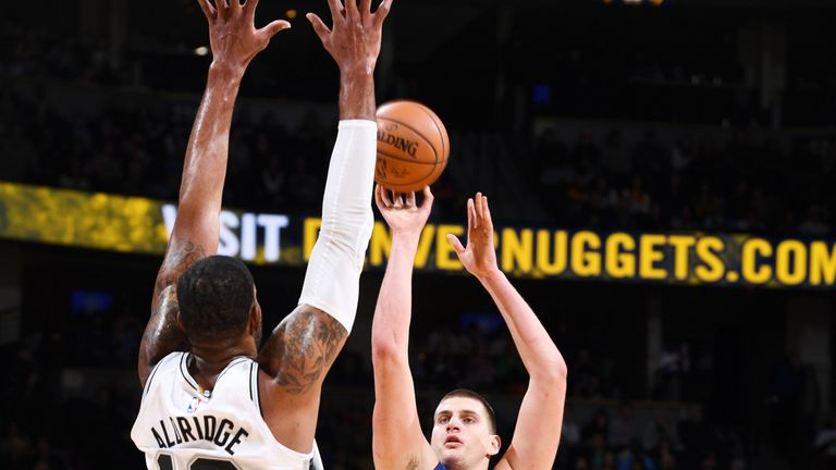 Nikola Jokic shoots over LaMarcus Aldridge