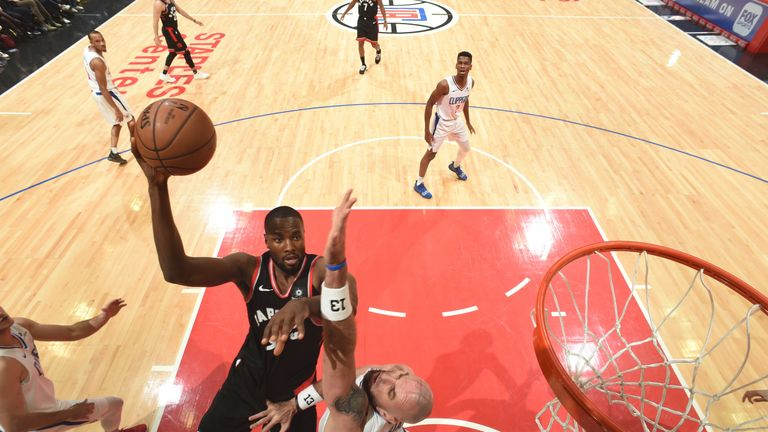 Serge Ibaka scores on Clippers center Marcin Gortat