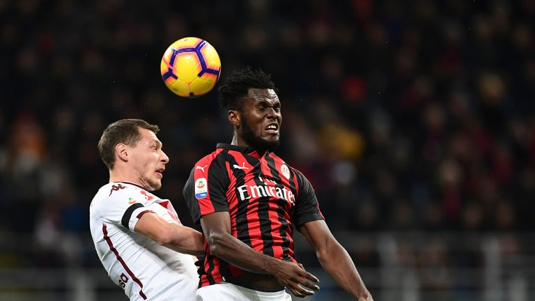 Andrea Belotti (L) fights for the ball with Franck Kessie (R)