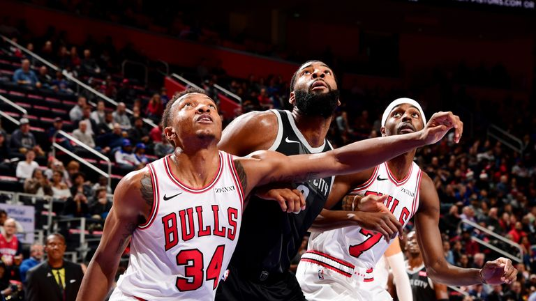 DETROIT, MI - NOVEMBER 30: Wendell Carter Jr. #34 of the Chicago Bulls and Andre Drummond #0 of the Detroit Pistons fight for position on November 30, 2018 at Little Caesars Arena in Detroit, Michigan. NOTE TO USER: User expressly acknowledges and agrees that, by downloading and/or using this photograph, User is consenting to the terms and conditions of the Getty Images License Agreement. Mandatory Copyright Notice: Copyright 2018 NBAE (Photo by Chris Schwegler/NBAE via Getty Images)