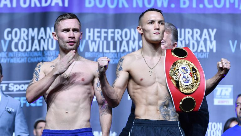 Carl Frampton (left) and Josh Warrington during the weigh-in at Manchester Central