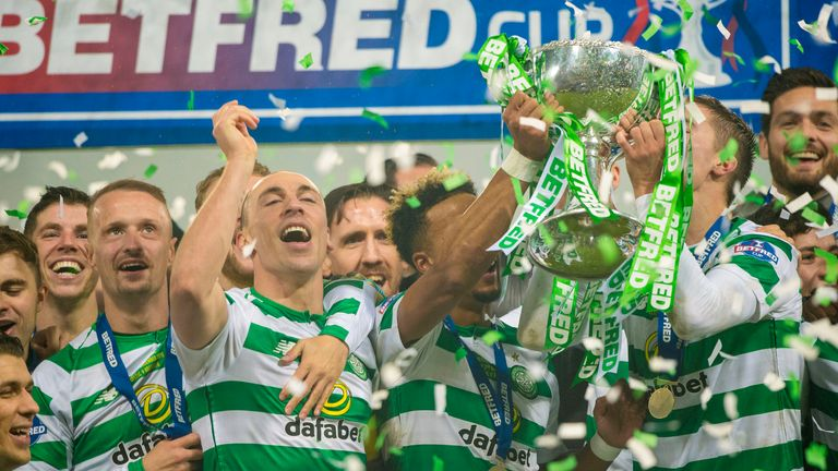 Celtic players celebrate their cup triumph - but are quickly back in league action