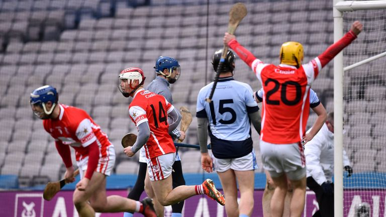 Cuala players celebrate the last-minute goal