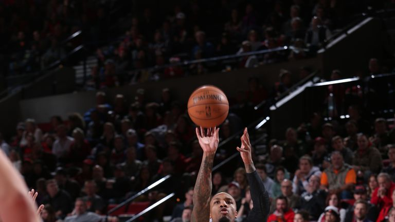 Damian Lillard #0 of the Portland Trail Blazers shoots the ball against the Minnesota Timberwolves on December 8, 2018 at the Moda Center Arena in Portland, Oregon.