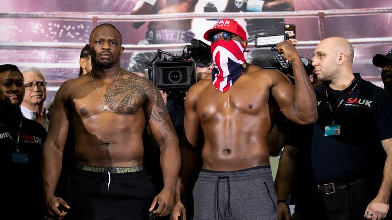 Whyte (left) and Chisora (right) weigh-in ahead of their rematch