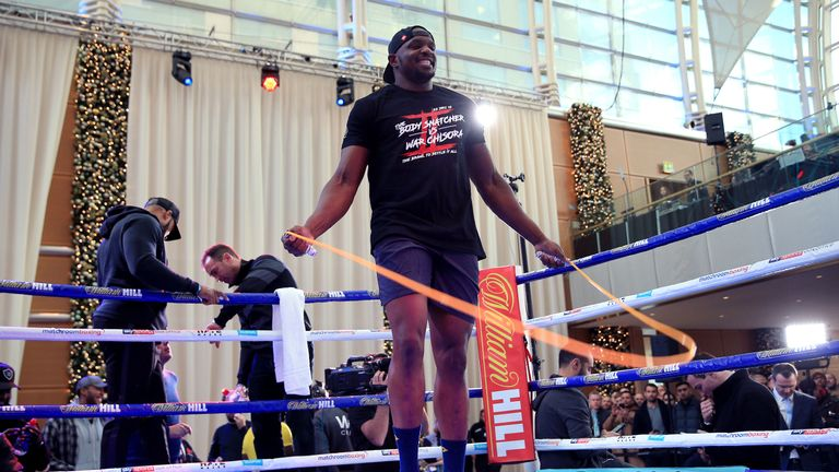 Dillian Whyte trains during the media workout