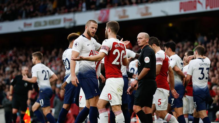 Eric Dier and Shkodran Mustafi exchange words following Tottenham's equaliser