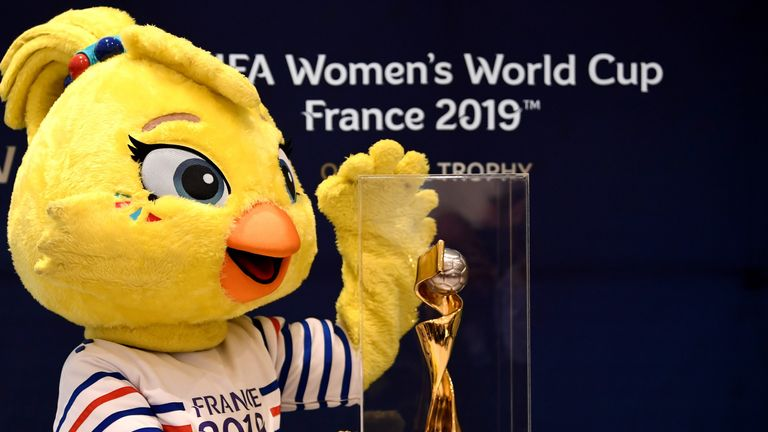 Ettie, the mascot of the 2019 FIFA Women's World Cup is presented next to the competition's trophy on December 7, 2018 in Boulogne-Billancourt, near Paris