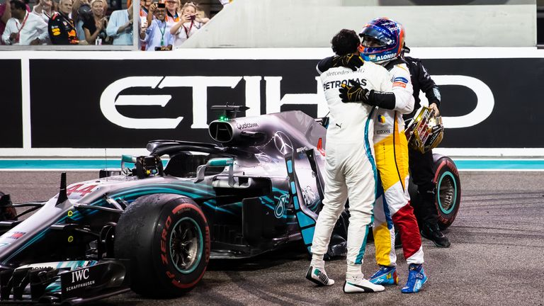After his final race in F1, Fernando Alonso is given a hug by Abu Dhabi GP victor Lewis Hamilton – his team-mate during a single, tumultuous season ten years earlier at McLaren. Picture by Lars Baron, Getty Images.