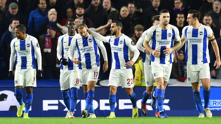 Glenn Murray celebrates with team-mates after scoring Brighton's first goal