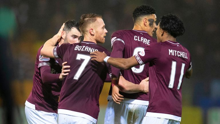 Hearts' Oliver Bozanic celebrates with his team-mates after firing his side back in front