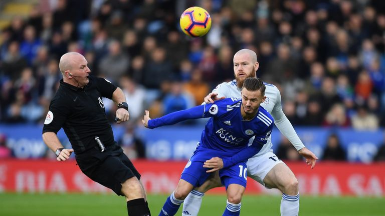James Maddison competes for the ball with Aron Gunnarsson