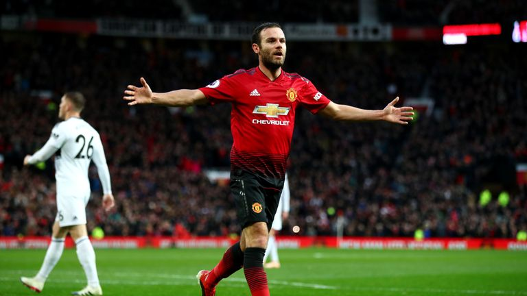 Juan Mata celebrates after scoring Manchester United's second goal of the game