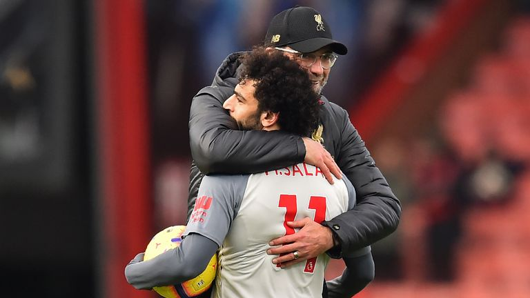Klopp embraces Mohamed Salah after his hat-trick